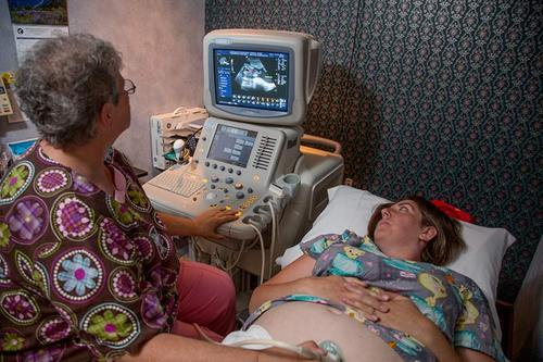 Technician giving patient an ultrasound