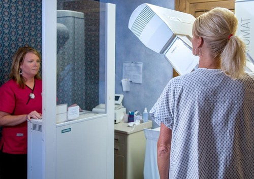 Patient receiving a mammogram